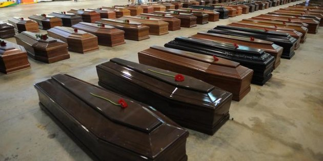 Coffin of victims are seen in an hangar of Lampedusa airport on October 5, 2013 after a boat with migrants sank killing more than hundred people. Italy mourned today the 300 African asylum-seekers feared dead in the worst ever Mediterranean refugee disaster, as the government appealed for Europe to stem the influx of migrants. Italian emergency services hoped to resume the search for bodies on October 5, 2013 despite rough seas after the accident, in which 111 African asylum-seekers are confirmed dead and around 200 more are still missing.   ANSA / ETTORE FERRARI